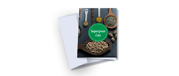 Example of a greeting card lying on top of a closed, white envelope. The greeting card contains a green circle with 'supergreen eats' written in white overlaid on an image of a table full of food ingredients. One of the greeting card templates available from Hatch.