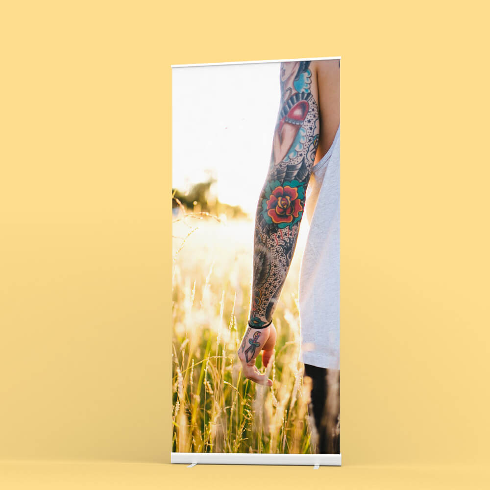 Roller banner offered by Hatch on a dark green background with a circle next to it and words 'from £24' inside