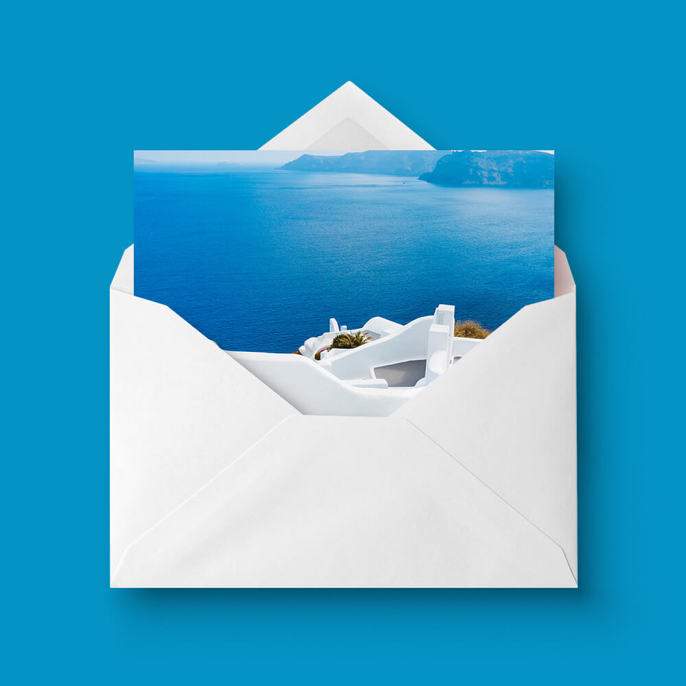 A greeting card printed by Hatch, popping out from a blank envelope and a circle next to it with words 'from £26' inside
