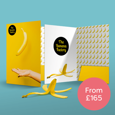 Two presentation folders printed by Hatch standing up on an aqua green background with a banana skin and a circle with 'from £165' next to them
