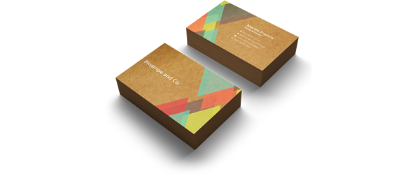 2 stacks, the front and back, of brown business cards, featuring cyan, red, yellow and brown triangular designs atop the cards decks. Represents 400gsm Kraft line of business cards from Hatch.