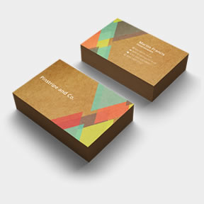 Two stacks of kraft business cards, printed by Hatch – offering design services.